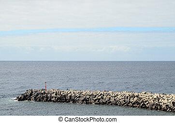 Stone Pier on the blue Atlantic Ocean Water
