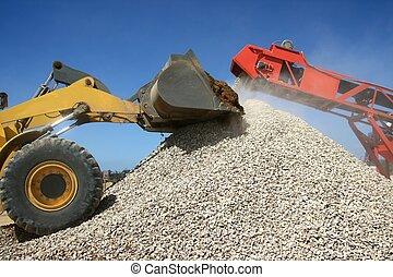 Stone Pile and Machines - Front end loader and conveyor belt...