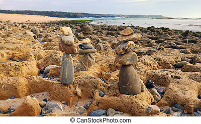 stone piles stacked on the beach