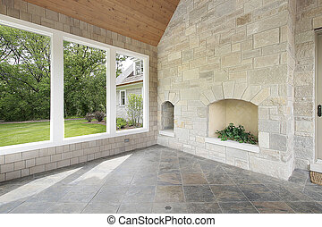Stone porch with fireplace
