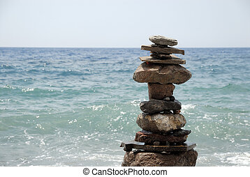 Stone pyramid on the beach in Greece