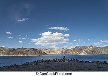 Stone pyramids at pangong lake background
