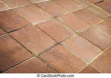Stone red tiles floor pattern