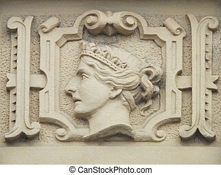 stone relief carving of queen victoria on an old building