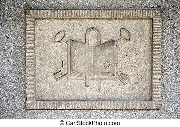 Stone relief with religion symbols