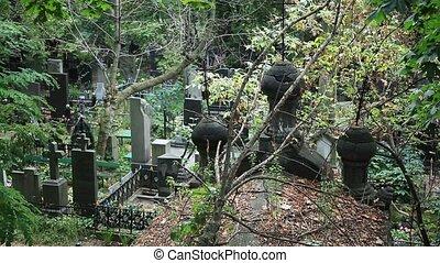 Stone religious crypt memorials in cemetery