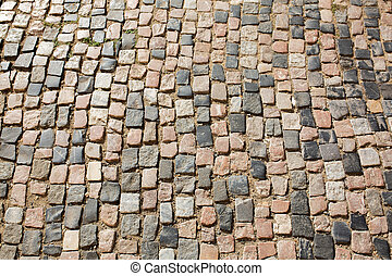 Stone road texture in sunny day