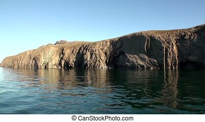 Stone rocks among water surface of Arctic Ocean on New Earth.