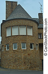 Stone rounded house tower with windows
