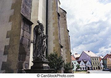 Stone sculpture of Saint near the Church in Czech Republic