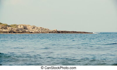 stone shore at sea on Sunny summer day.