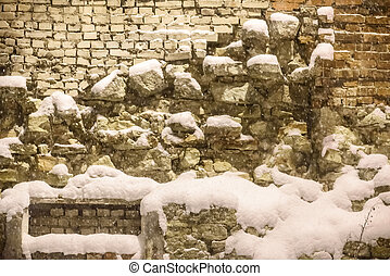 Stone snow under snow. Texture of a stone and snow.
