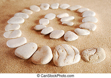 Spiral from sea stones on sand at the sea