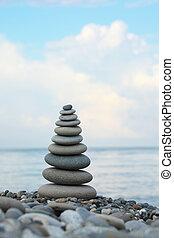 stone stack on pebble beach