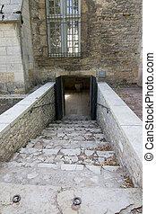 Stone staircase going down to cellar