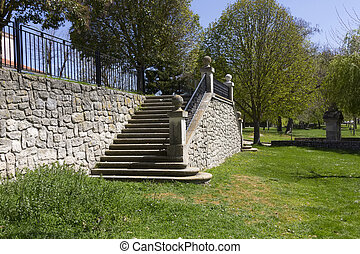 stone staircase in a garden of green boil