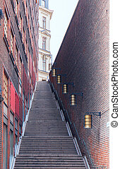 stone staircase in the city. The narrow street leading to the top