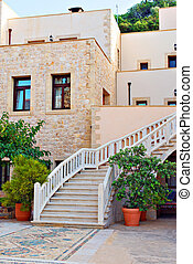 Stone stairs in front of house entrance.
