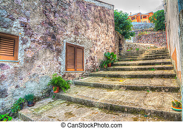 stone stairway in an old narrow street with plants and ruined brick walls. iso 100, heavy processing for hdr tone mapping effect.