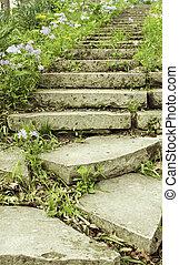 Stone stairway on a garden path vertical