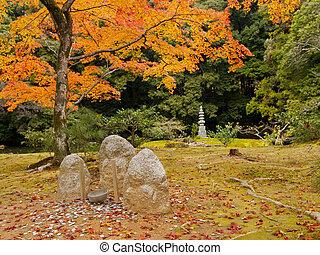 Stone statuary and a rock pagoda in Kinkakuji temple (The gloden pavilion temple) in Kyoto, Japan