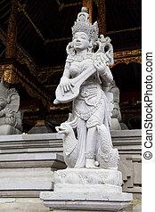 Stone Statue at Tirtha Empul Temple, Bali, Indonesia