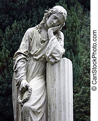 Stone statue of a grieving young woman.
