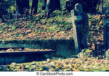 stone statue in the cemetery