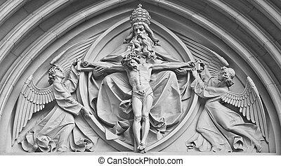 Stone statue jesus christ, god and angel on church in...