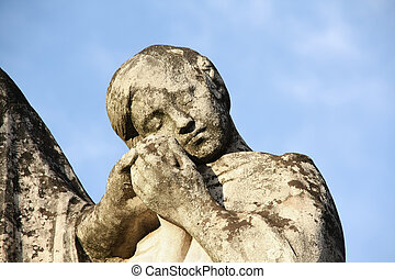 Stone Statue of a child holding her mother hand