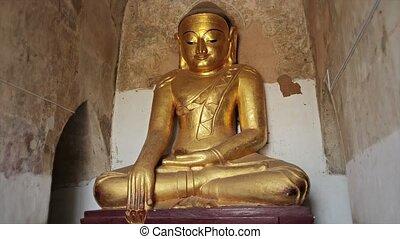 Stone statue of a sitting Buddha close up. Bagan, Burma -...