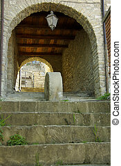 Stone Steps Leading To Arched Walkway