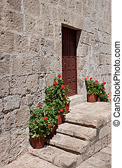 Monasterio de Santa Catalina - Stone steps lined with potted...