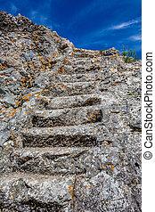 Stone steps of stairway carved in granite rock