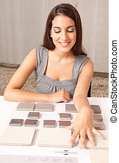 Stone Swatch Tiles - A designer looking at stone swatch...