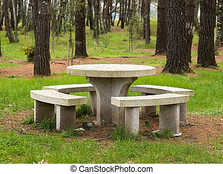 Stone table and benchs in a park - Table and benchs in a...