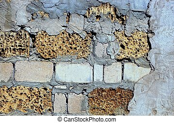 stone texture of bricks and plaster on the wall