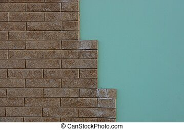 stone texture of brown bricks and green plaster on the wall