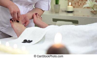 Stone Therapy - Woman enjoying stone therapy