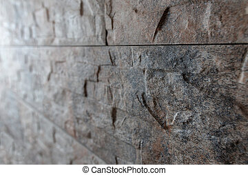Stone tile glued to the wall