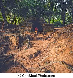 Stone tomb in Angkor temple ruins, Siem Reap, Cambodia.