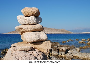 Stone tower, Halki island - A tower of stones on Ftenagia...
