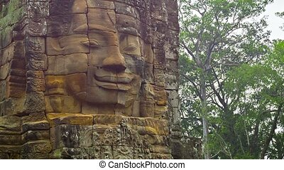 Stone tower of old temple with face. 12th - 13th century....