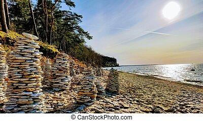 Stone towers on Baltic sea beach