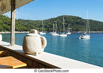 Stone vase and Panoramic view on Saplunara harbor. Mljet, Croatia