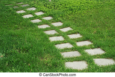 stone walkway on the grass