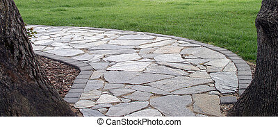 Stone Walkway - Stone walkway framed by two trees and...