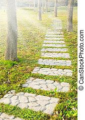 Stone walkway winding in park
