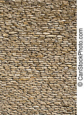 the detail of a wall made of stones