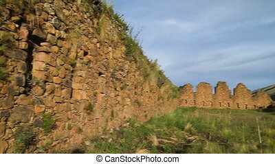 Stone Wall and Taller Side of Wall - Handheld, panning shot...
